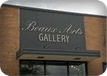 Beaux Arts unlit metal lettering, spotlighted, in Texas