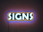 SIGNS! internally lighted channel letters with neon border and multi-colored backlighting by Signs Manufacturing