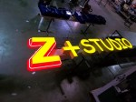 Z+Studio face-lit channel letters with neon border and backplate by Signs Manufacturing