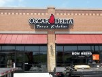 Oscar Delta channel letter sign with channel box and backplate in Forney by Signs Manufacturing of Dallas TX